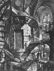 """Giovanni Battista Piranesi: """"Carceri d´invenzione"""" (Cárceles imaginarias) - Carcel III """"La torre circular"""" (1750) - La imagen muestra un interior bastante oscuro, iluminado por ventanas situadas en la parte superior, en donde se aprecia una gran torre circular en la parte central a partir de la cual salen diversas escaleras y pasarelas que llevan a otros lugares que apeneas se aprecian por la oscuridad. El conjunto es como un juego de perpectivas que da a la prisión un carácter de laberinto agobiante. Pulse para ampliar."""