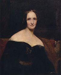 Mary Shelley. Retrato pintado por Richard Rothwell (1840) - La imagen muestra un retrato en plano medio (cortado a la altura de la cintura) de una mujer de mediana edad, vestida de negro con un traje que deja los hombros al descubierto y de rasgos lánguidos y melancólicos. Pulse para ampliar.
