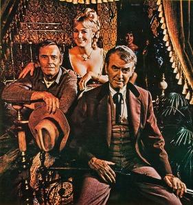"""Fotografía promocional de """"El club social de Cheyenne"""" (Gene Kelly, 1970) - La imagen muestra a los tres protagonistas de la película: James Stewart, Henry Fonda y Sue Anne Langdon. Pulse para ampliar."""