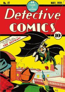 Portada del primer número de Batman (mayo 1939) - La imagen muestra la portada a todo color de la revista ilustrada Detective Comics en la que aparecen dos hombres vestidos con traje y sombrero de espaldas que miran asombrados como Batman les trae volando un delincuente. Pulse para ampliar.
