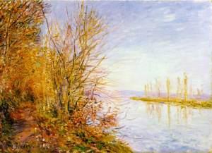 Alfred Sisley - El camino del bosque. Veranillo de San Martin (1880) -La imagen muestra un camino en primer plano, bordeado de árboles en los que las hojas tienen un color rojizo. En la parte izquierda se aprecia el río, en tonos aúles grisáceos y la otra orilla, alejada, en tonos marrones tambien. El cielo aparece de color azul plomizo. Pulse para ampliar.