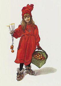"""Carl Larsson - """"Brita como Iduna, la diosa de las manzanas"""" (1901) - La imagen muestra a una niña vestida de rojo con un gorro en forma de turbante también de color rojo. Lleva botas con ribetes de piel. En su mano izquierda sostiene un cesto lleno de manzanas y con la derecha ofrece tres velas encendidas de las que penden sendos hilos con manzanas. Mira al espectador risueña y sonriente. Pulse para ampliar."""