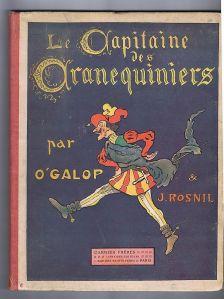"""Portada de la 1ª edición de """"El capitán de los ballesteros"""" de Jean Rosnil, con ilustraciones de O´Galop - La imagen muestra la cubierta de un libro. En la parte superior el título (en francés) en letras de tipo gótico, muy adornadas. Debajo aparece una figura vestida a la manera militar con gesto enfadado y que está dándole una patada al aire. Aparecen los nombres de O´Galop para las ilustraciones y Jean Rosnil para el texto. Pulse para ampliar."""
