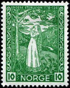 La imagen muestra un sello de correos de forma casi cuadrada, de color verde y en el que aparece una escena en la que una mujer joven con el pelo muy largo y suelto, que le llega casi hasta la cintura, se apoya en el tronco de un árbol y mira hacia arriba, a las ramas. Pulse para ampliar.