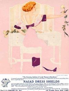 La imagen muestra un anuncio publicitario en color. Ocupando casi toda la página está la ilustración de una mujer, sentada ante un tocador. El fondo de la imagen es rosa pálido, el tocador blanco y la mujer lleva un vestido del mismo tono que la pared. Por eso, en los lugares en donde la pared y el vestido se superponen, parece que el cuerpo de la mujer ha desaparecido. Pulse para ampliar.