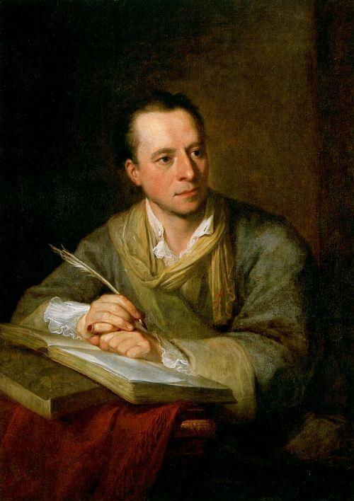 La imagen muestra un retrato de un hombre sentado a una mesa sobre la que se ven varios libros y papeles. El hombre, de semblante serio, sostiene una pluma en su mano derecha y parece estar pensativo y concentrado. Pulse para ampliar.